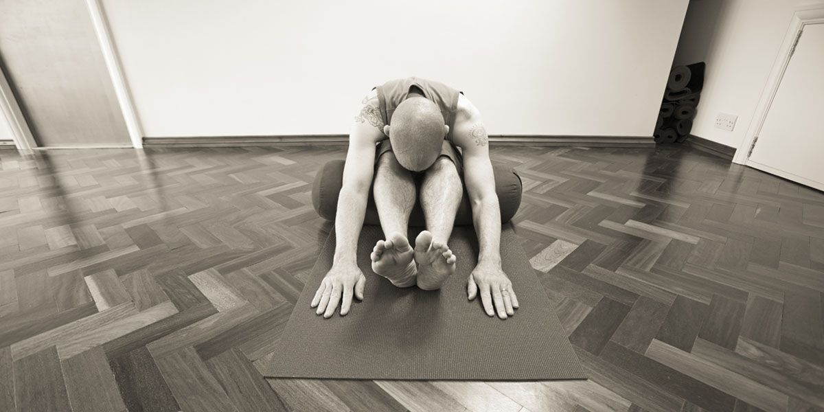 Norman in a supported forward bend posture
